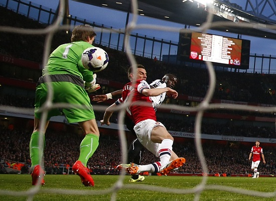 Arsenal's Koscielny scores a goal against Newcastle United during their English Premier League soccer match in London