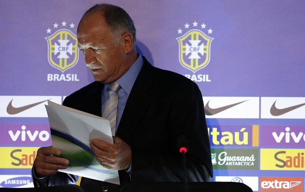 Brazilian national soccer team head coach Scolari arrives with a player list before a news conference in Rio de Janeiro