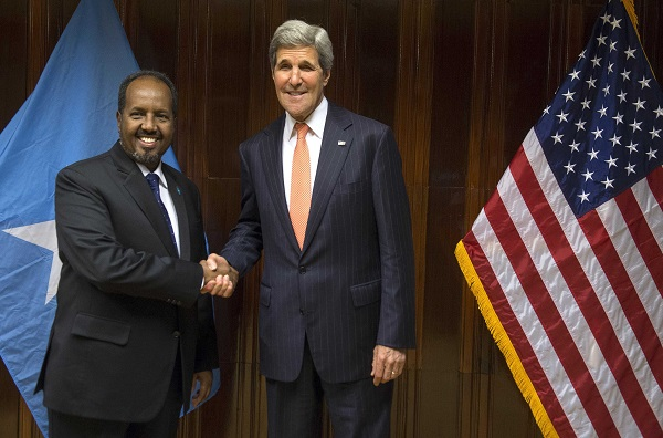 -U.S. Secretary of State Kerry and Somalia's President Mohamud shake hands before a meeting at Addis Ababa Bole International Airport