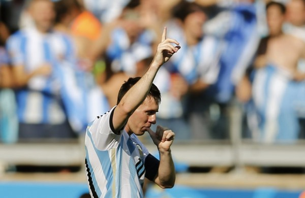 Argentina's Lionel Messi celebrates after scoring a goal during the 2014 World Cup Group F soccer match between Argentina and Iran at the the Mineirao stadium
