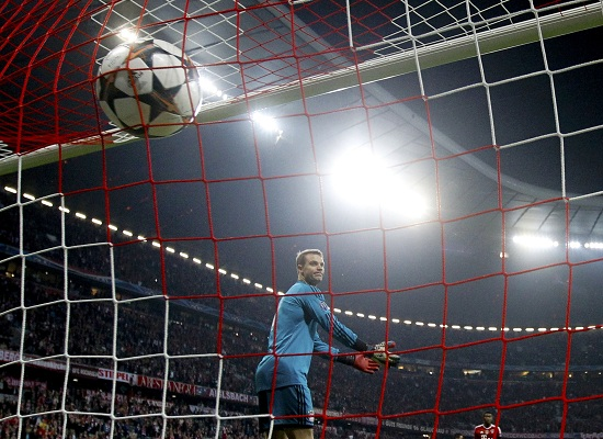 Bayern Munich's goalkeeper Neuer reacts after Real Madrid's Ronaldo scored a free kick during their Champions League semi-final second leg soccer match in Munich