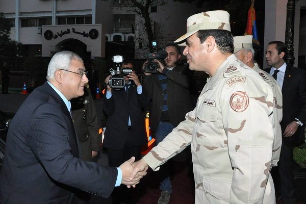 Egypt's interim President Mansour shake hands with Egypt's army chief Field Marshal Sisi after his meeting with members of the Supreme Council of the Armed Forces, in Cairo