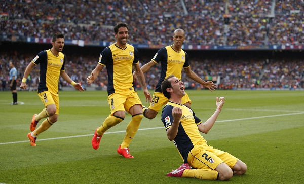 Atletico Madrid's Godin celebrates after scoring against Barcelona during their Spanish first division soccer match in Barcelona