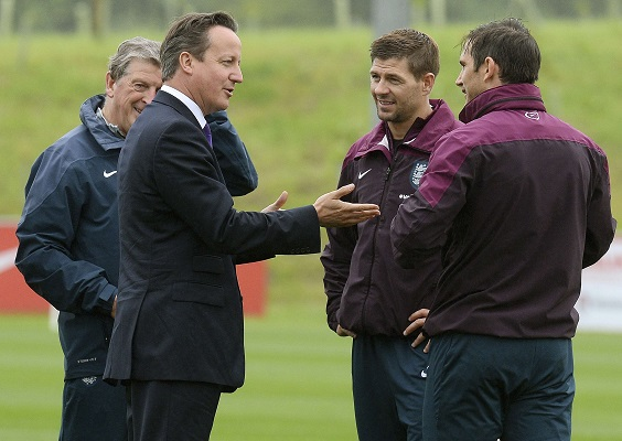 Britain's Prime Minister Cameron meets England's national soccer team members during a visit to England's national soccer training headquarters of St George's Park in Burton-Upon-Trent, central England