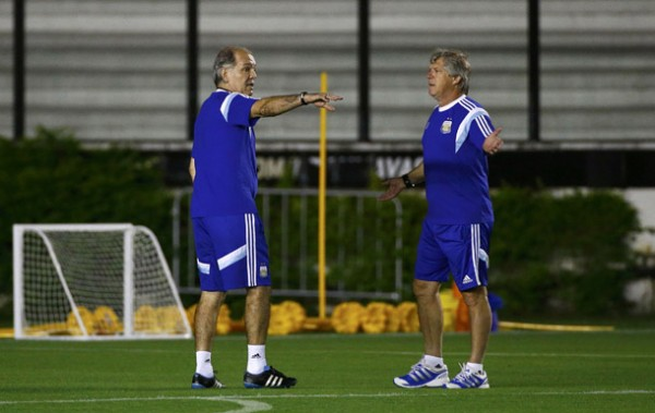 Argentina's coach Sabella talks to an unidentified member of his staff prior to a training session in Rio de Janeiro