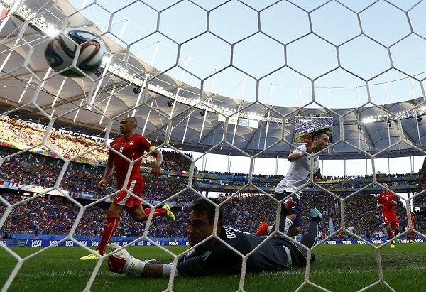 France's Mathieu Valbuena scores their third goal during their 2014 World Cup Group E soccer match against Switzerland at the Fonte Nova arena in Salvador
