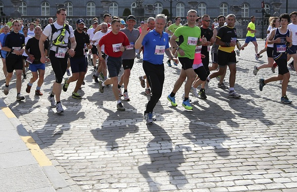 Belgium's King Philippe waves as he takes part in the Brussels 20km running race