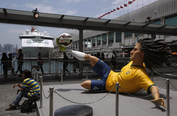 A figure of Brazil's David Luiz is displayed along with seven other football stars outside a shopping mall in Hong Kong, ahead of the 2014 World Cup in Brazil