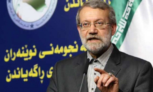 Iranian Parliament's speaker Ali Larijani speaks during a joint press conference with his Iraqi counterpart Salim al-Jabouri (unseen) following a meeting on December 24, 2014 in the Iraqi capital Baghdad.    AFP PHOTO / ALI AL-SAADI        (Photo credit should read ALI AL-SAADI/AFP/Getty Images)
