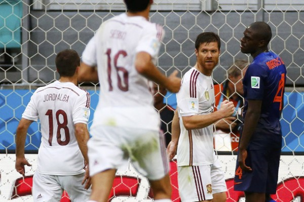 Spain's Alonso celebrates after scoring his penalty against the Netherlands during their 2014 World Cup Group B soccer match at the Fonte Nova arena in Salvador