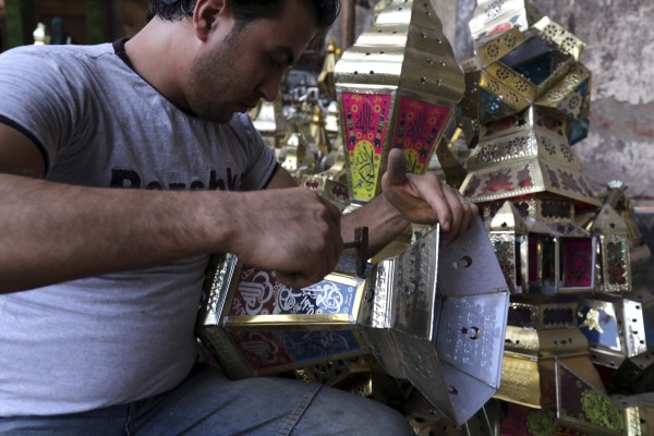 """A workman makes a traditional Ramadan lantern known as """"fanous"""" ahead of the holy fasting month of Ramadan in Cairo"""