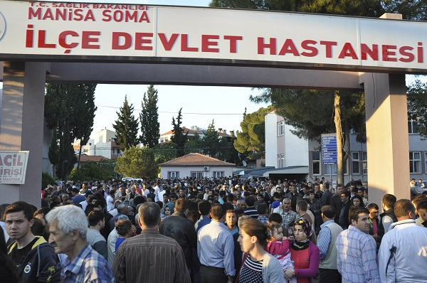 Locals and relatives of miners who are trapped in a coal mine wait in front of a hospital in Soma, a district in Turkey's western province of Manisa