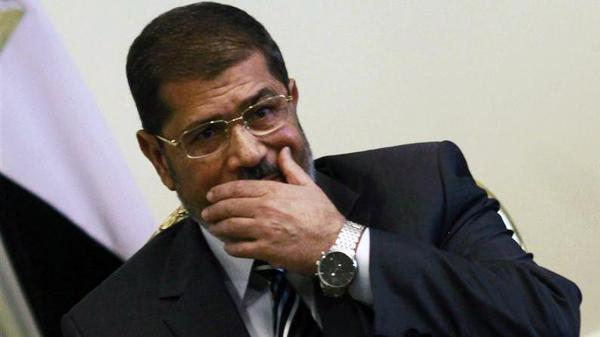 Egypt's President Mursi attends a meeting with U.S. Secretary of State Clinton at the presidential palace in Cairo