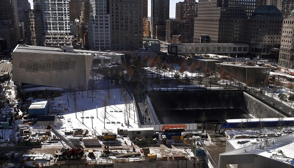 The north reflecting pool at the 911 Memorial is seen next to the still under construction 911 museum in this general view of the site in New York in this file photo