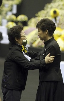 South Korea's President Park comforts a mourner after paying tribute to victims of sunken passenger ship Sewol, at the official memorial altar for the victims in Ansan