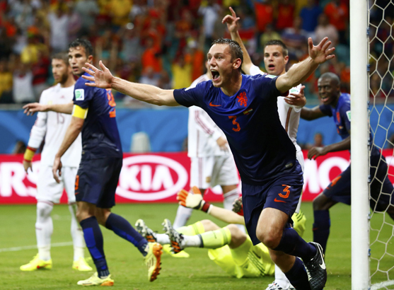 de Vrij of the Netherlands celebrates after scoring a goal against Spain during their 2014 World Cup Group B soccer match at the Fonte Nova arena in Salvador