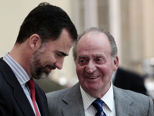 File photo of King Juan Carlos talking to his son Prince Felipe at El Pardo Palace