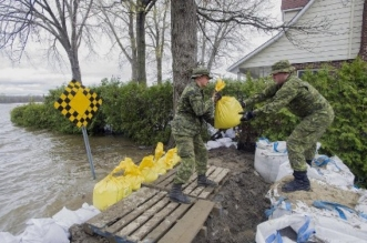 بالصور.. فيضانات غير مسبوقة في كندا جراء الأمطار الغزيرة - المواطن