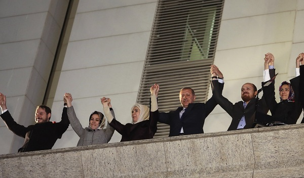 Turkey's Prime Minister Tayyip Erdogan greets his supporters with his family members in Ankara