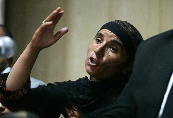 Khalida Bibi, sister of the late Farzana Iqbal, speaks during a news conference in Lahore