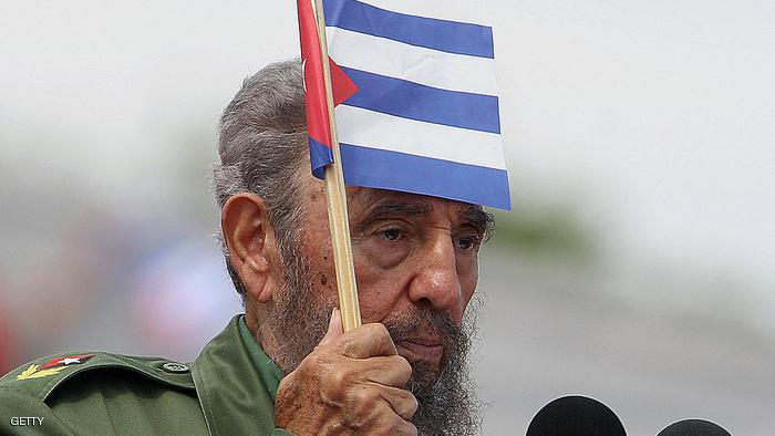 (FILES) Picture dated 01 May 2006 showing Cuban President Fidel Castro with a national banner during the May Day ceremony in Havana. Fidel Castro resigned on February 19, 2008 as president and commander in chief of Cuba in a message published in the online version of the official daily Granma   AFP PHOTO/Adalberto ROQUE (Photo credit should read ADALBERTO ROQUE/AFP/Getty Images)