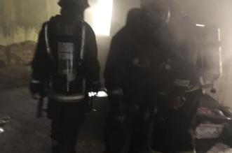 بالصور .. انقاذ 7 أشخاص بحريق عمارة سكنية بالمدينة