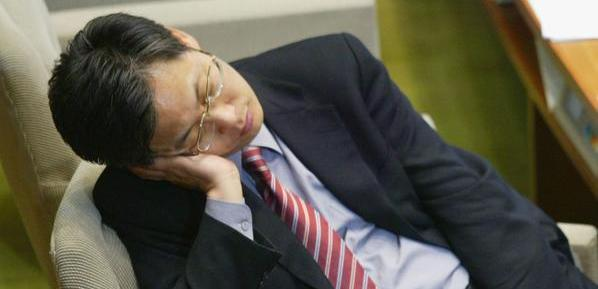 SEOUL, SOUTH KOREA - DECEMBER 31: Lawmakers of the main opposition Grand National Party sleep at the National Assembly on December 31, 2004 in Seoul, South Korea. They have continued to occupy the Assembly floor since Thursday evening to prevent rival ruling Uri Party legislators from passing their party's reform bills, including the one calling for the abolition of the National Security Law. (Photo by Chung Sung-Jun/Getty Images)