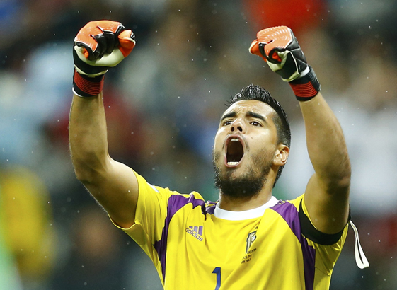 Argentina's goalkeeper Romero celebrates after saving the ball for the second time during a penalty shoot-out at their 2014 World Cup semi-finals against the Netherlands at the Corinthians arena in Sao Paulo
