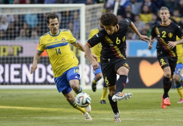 Sweden's Hysen and Belgium's Witsel fight for the ball during  their international friendly soccer match in Solna