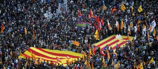 Anti-royalist protesters show Catalan separatist flags during a demonstration at Catalunya square in Barcelona