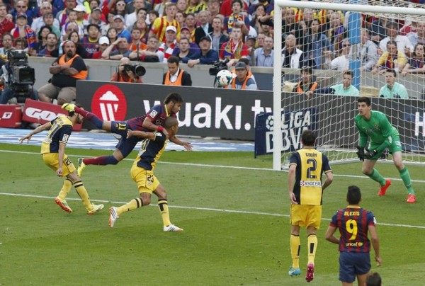 Barcelona's Neymar attempts to score against Atletico Madrid in the final minutes of their Spanish first division match in Barcelona