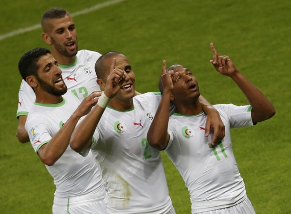 Algeria's national soccer players celebrate their team's fourth goal by Brahimi during their 2014 World Cup Group H soccer match at the Beira Rio stadium in Porto Alegre