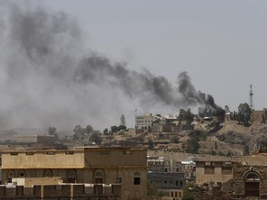 Smoke rises from the headquarters of the Yemeni state television building, which is under attack from Shi'ite Houthi militants, in Sanaa