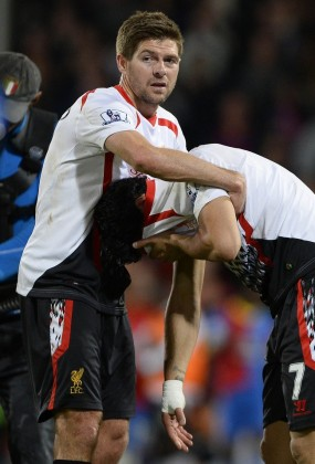Liverpool's Gerrard and Suarez react following their English Premier League soccer match against Crystal Palace at Selhurst Park in London